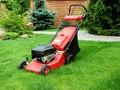 Lawnmower standing on green grass