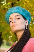 Beautiful girl enjoying the autumn, sunny day