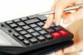 hand and calculator