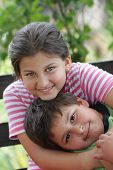 Brother and sister hugged and smiling