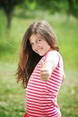 Young girl with thumb up