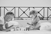 Kids Playing With Toys. Smart Toddler Concept. Parent Play Chess With Kid On Terrace On Sunny Day. D poster