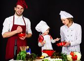 Happy Family In Kitchen. Healthy Food At Home. Adorable Kid In Chef Hat. Preparation To Dinner. Pare poster