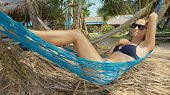 Young Happy Woman In Beachwear Lying On Hammock At The Sandy Island Beach poster