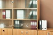 bookcase with glass doors in a modern office
