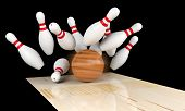 Постер, плакат: Bowling Strike Scattered Skittle And Bowling Ball On Bowling Lane With Motion Blur On Bowling Ball
