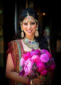 Smiling Indian Bride With Bouquet