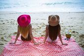 Young Couple Friend Women Sunbathe At The Beach; Summer Holiday And Relax Concept. poster