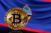 Постер, плакат: Gold Coin Bitcoin On A Background Of A Flag Guam