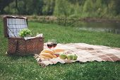 Everything For Romantic Picnic. Healthy Food And Glasses Of Wine On Blanket. Picnic Basket Is On The poster