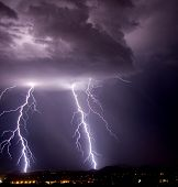 picture of lightning bolts  - thundershower and lightning over city and mountains - JPG