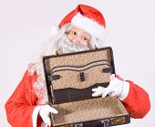 Santa Claus with open suitcase