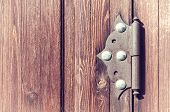 Wooden Weathered Door With Old Metal Door Hinge, Architecture Background With Vintage Architecture D poster
