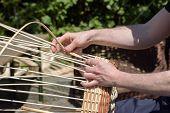 Hands Of A Basket Maker Weave A Wicker Basket poster