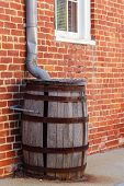 A Rain Collection Wooden Barrel That Is Missing A Stave poster