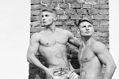 Young Handsome Twins With Sexy Muscular Athletic Strong Body Has Bare Torso And Strong Belly Posing  poster