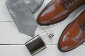 Stylish Mens Accessories. Brown Shoes With Cuff, Tie And Perfume poster