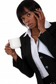 pic of coffee-cup  - businesswoman on the phone having cup of coffee - JPG
