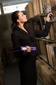 Business woman stock counting in warehouse