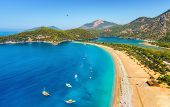 Amazing Aerial View Of Blue Lagoon In Oludeniz, Turkey. Summer Landscape With Sea Spit, Boats And Ya poster