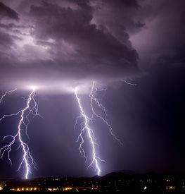 image of lightning bolt  - thundershower and lightning over city and mountains - JPG