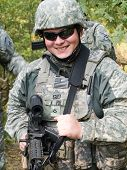 picture of army soldier  - The portrait of the smiling US Army soldier with machine gun - JPG