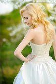 Portrait Of A Beautiful Bride In A Lush Garden