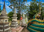Tombstone Buddhism, Old Graves On Asian Cemetery poster
