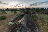 Landscape In The Barruecos Natural Area. Spain. In The Foreground There Is An Anthropomorphic Tomb O poster