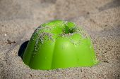 Green Sand Mould As A Cake Mould Like A Ball Cake Lies In The Granular Sand And Is Sprinkled With Sa poster