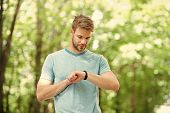Modern Technology. Wrist Band Gadget. Athlete Check Fitness Tracker Nature Background. Athlete With  poster