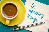 Do amazing things - inspirational note on a napkin with a cup of coffee. Inspiration and creativity  poster
