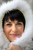 Woman wearing fur hood
