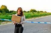 Young Criminalist With Laptop On A Crime Scene