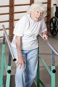 Portrait of senior woman having ambulatory therapy.