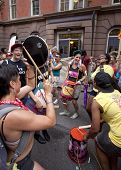 NEW YORK - JUNE 22: Supporters play homemade drums and dance outside of the LGBT Community Center du