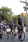 NEW YORK - JUNE 22: Supporters walk their bikes as they march past Christopher Street and Hudson St