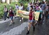 NEW YORK - JUNE 22: Supporters holding signs and banners march through Washington Square Park on the
