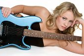 image of rock star  - Pretty young blonde rock star holding her guitar - JPG