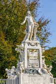 Mozart Statue With Flower Decoration In The Form Of A Musical Treble Clef Key, Vienna, Austria poster