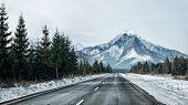 Panoramic View Of An Empty Road In The Mountains Leading Straight Into The High Snowy Peaks (hdr Int poster