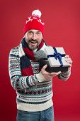Caucasian Man Wear Warm Clothes Hold Present Package. Knitwear Accessories. Winter Trends. Knitted H poster