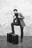 Best Travel Bags For Men. Guy Well Groomed Elegant Bearded Man And Vintage Suitcase. Time Traveller  poster