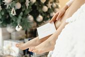 Beautiful Woman Legs  Near Christmas Tree. Comfortable Home Concept. Warm Winter Evening.woman Body  poster