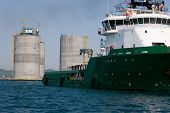 Ocean tug towing the base oil drilling platform. Sea Japan. Russian coast.