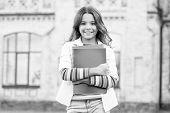 Modern Education. Kid Smiling Girl School Student Hold Workbooks Textbooks For Studying. Education F poster