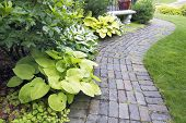 Garden Paver Path With Plants And Grass