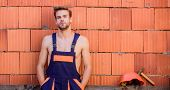 Handsome Man Wear Overalls. Break For Relax. Sexy Laborer. Attractive Worker. Construction. Worker B poster