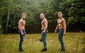 Little Break. Bodybuilders In Jeans. Three Sexy Guys. Brutal Guys Pose With Naked Torso. Handsome Gu poster
