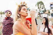 Brazilian Carnival. Woman In Costume Drinking Water poster